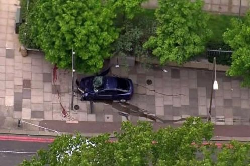 Another-helicopter-scene-photo-from-terrorist-attack-in-Woolwich-Shows-crashed-car-with-blood-on-pavement-1905511