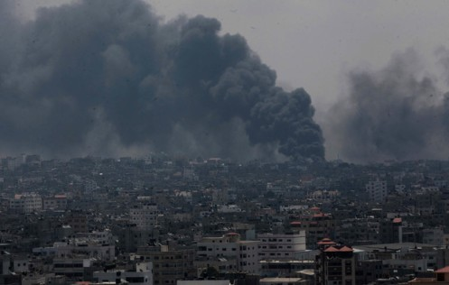 Smoke rises after an Israeli missile hit Shajaiyeh neighborhood in Gaza City