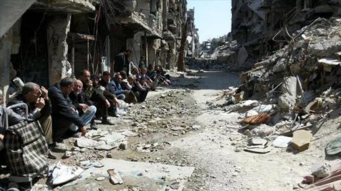 Habitantes del campo de refugiados de Al-Yarmuk en Damasco, Siria