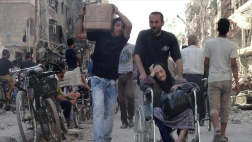 Refugiados palestinos del campo de Al-Yarmuk en Damasco, capital siria