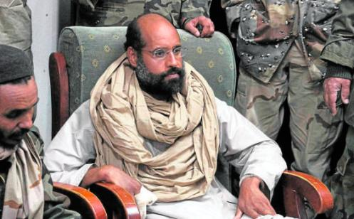 Saif al-Islam is seen after his capture, in the custody of revolutionary fighters in Obari, Libya November 19, 2011. Libya's prime minister-designate said Saif al-Islam would receive a fair trial in Libya. That could lead to conflict with the Hague-based International Criminal Court, which has indicted Saif al-Islam for crimes against humanity. Picture taken November 19, 2011. REUTERS/Ammar El-Darwish (LIBYA - Tags: POLITICS CIVIL UNREST TPX IMAGES OF THE DAY)
